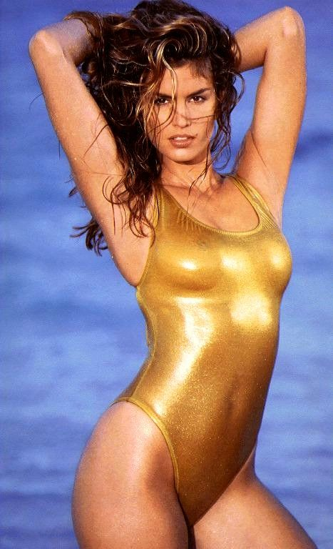 This One Piece Transformed Cindy Into A Golden Goddess Of The Sea The Sunset Backdrop Was A Common Theme For Her Yearly Swimsuit Calendars